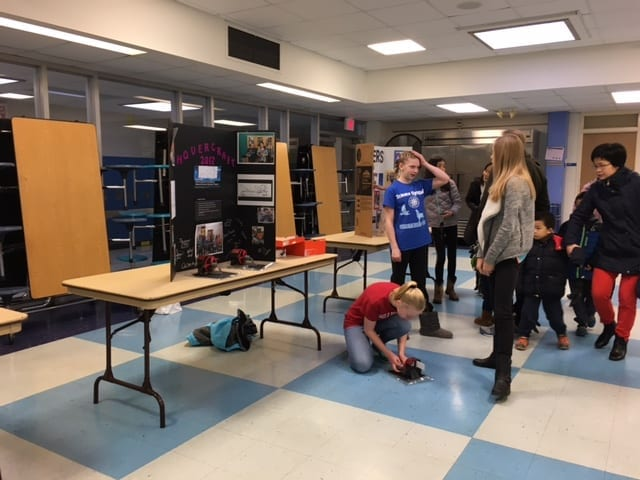 Madison Sloane and Halle Fink show off their Science Olympiad work at the February 25th Open House.